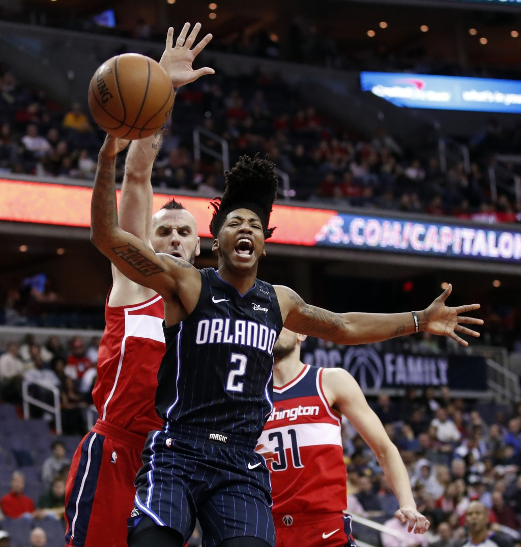 Orlando Magic guard Elfrid Payton (2) reacts after he was fouled while shooting against Washington Wizards center Marcin Gortat (13), from Poland, and