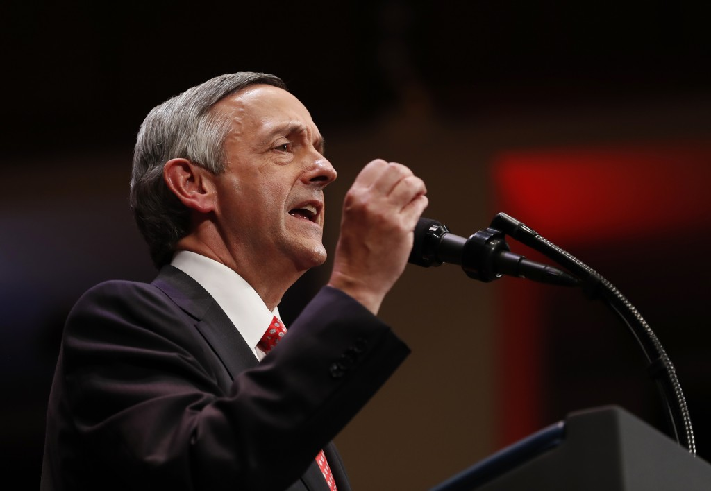FILE - In this July 1, 2017, file photo, Pastor Robert Jeffress of the First Baptist Dallas Church Choir speaks as he introduces President Donald Trum
