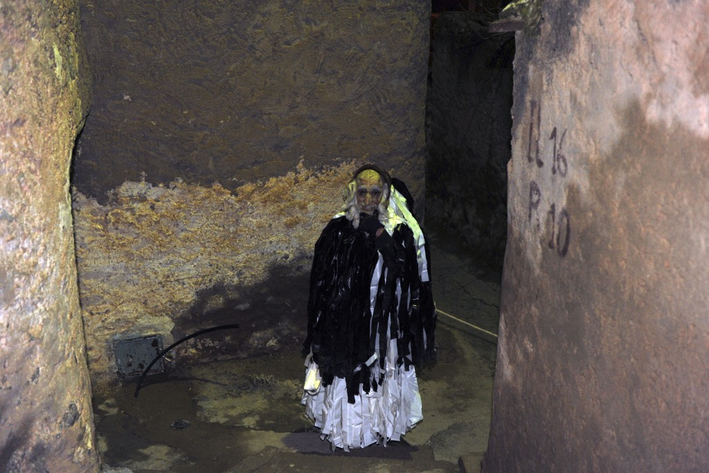A disguised man strolls through the village of Beni Snous, south of Tlemcen, Algeria, Thursday, Dec.11, 2018. Algerians in the Beni Snous region dress