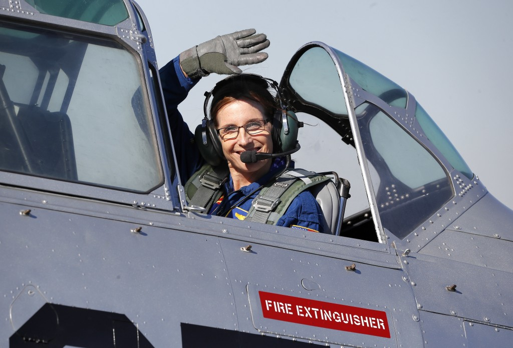 U.S. Rep. Martha McSally, R-Ariz., waves from the cockpit of a T-6 World War II airplane as she departs from a rally, Friday, Jan. 12, 2018, in Phoeni