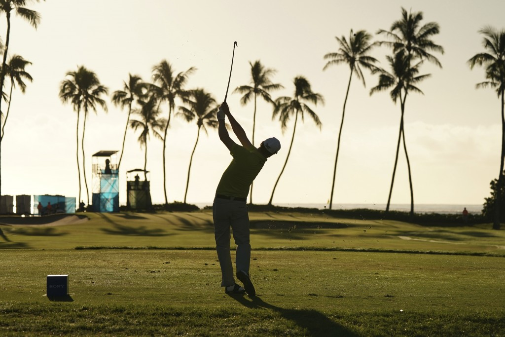 Zach Johnson hits off the 11th tee during the second round of the Sony Open golf tournament, Friday, Jan. 12, 2018, in Honolulu. (AP Photo/Marco Garci