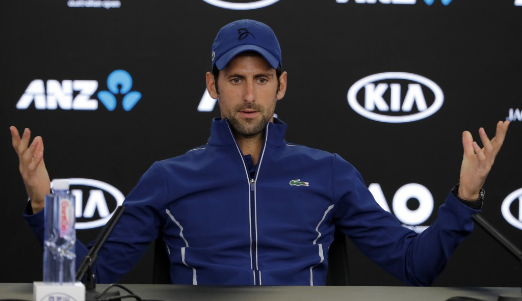 Serbia's Novak Djokovic gestures during a press conference at the Australian Open tennis championships in Melbourne, Australia, Saturday, Jan. 13, 201