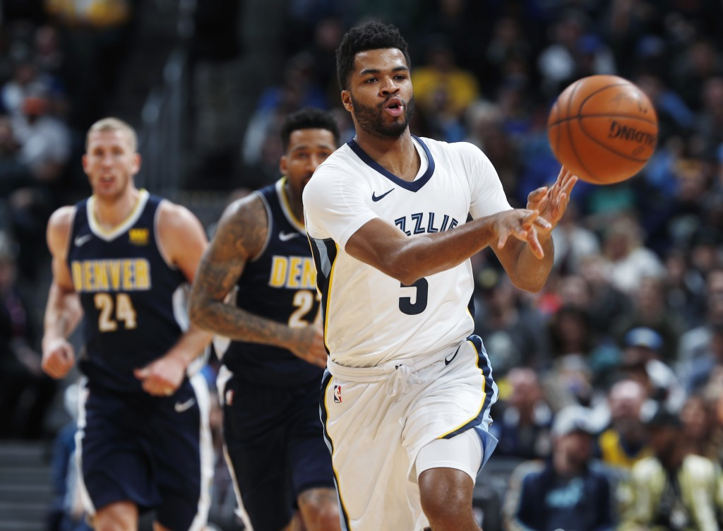 Memphis Grizzlies guard Andrew Harrison, front, passes the ball on a fast break as Denver Nuggets forward Wilson Chandler and center Mason Plumlee, ba