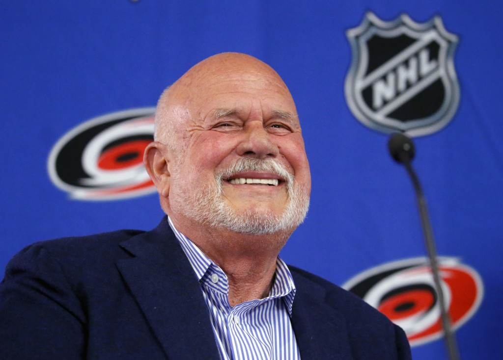 Former Carolina Hurricanes NHL hockey team majority owner Peter Karmanos laughs during a press conference where Thomas Dundon was introduced as the ne
