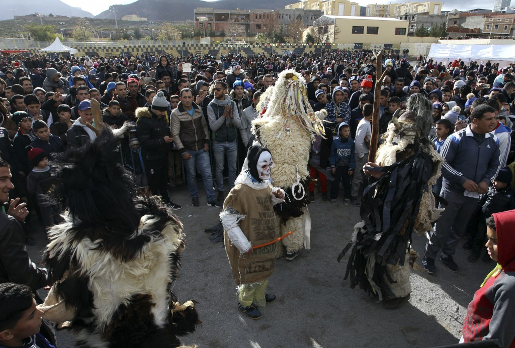 Performers dressed in animal-hide costumes entertain the crowds as part of the Ayred festival in the village of Beni Snous, south of Tlemcen, Algeria,
