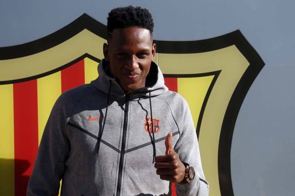 Colombia's soccer player Yerry Mina gestures at the Camp Nou stadium in Barcelona, Spain, Friday, Jan. 12, 2018. A few days after signing Philippe Cou