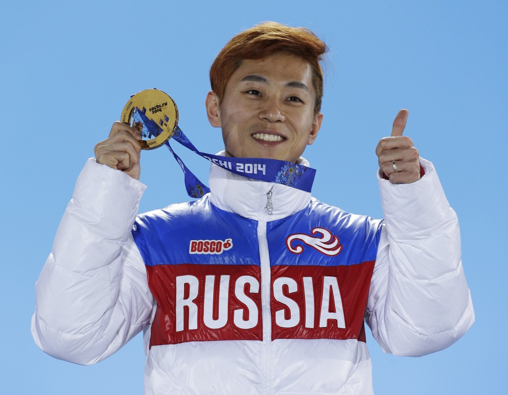 FILE - In this Feb. 15, 2014, file photo, men's 1,000-meter short track speedskating gold medalist Viktor Ahn, of Russia, gestures while holding his m