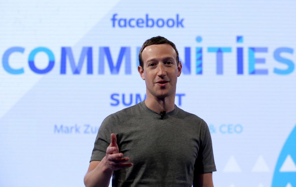 FILE - In this Wednesday, June 21, 2017, file photo, Facebook CEO Mark Zuckerberg speaks as he prepares for the Facebook Communities Summit in Chicago