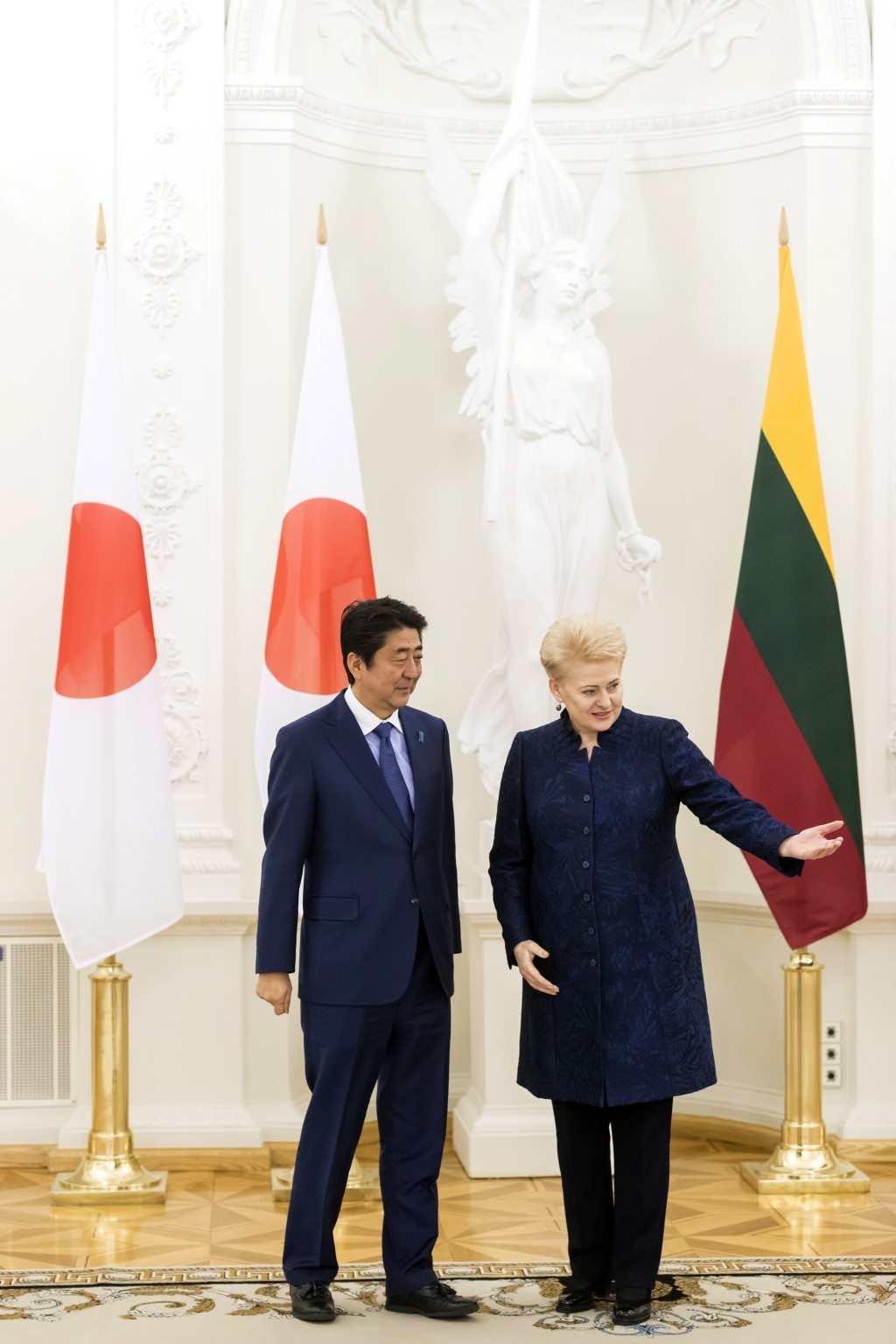 Lithuania's President Dalia Grybauskaite, right, speaks to the Japanese Prime Minister Shinzo Abe prior to their meeting at the Presidential palace in