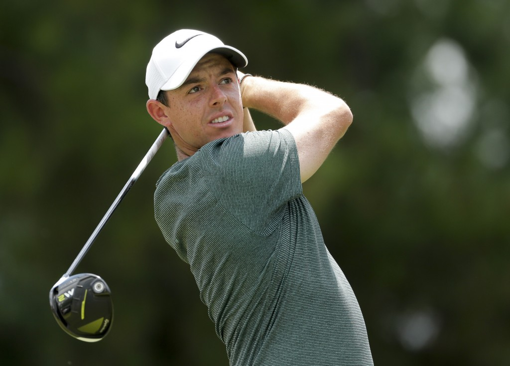 FILE - In this Aug. 12, 2017, file photo, Rory McIlroy watches his tee shot on the third hole during the third round of the PGA Championship golf tour