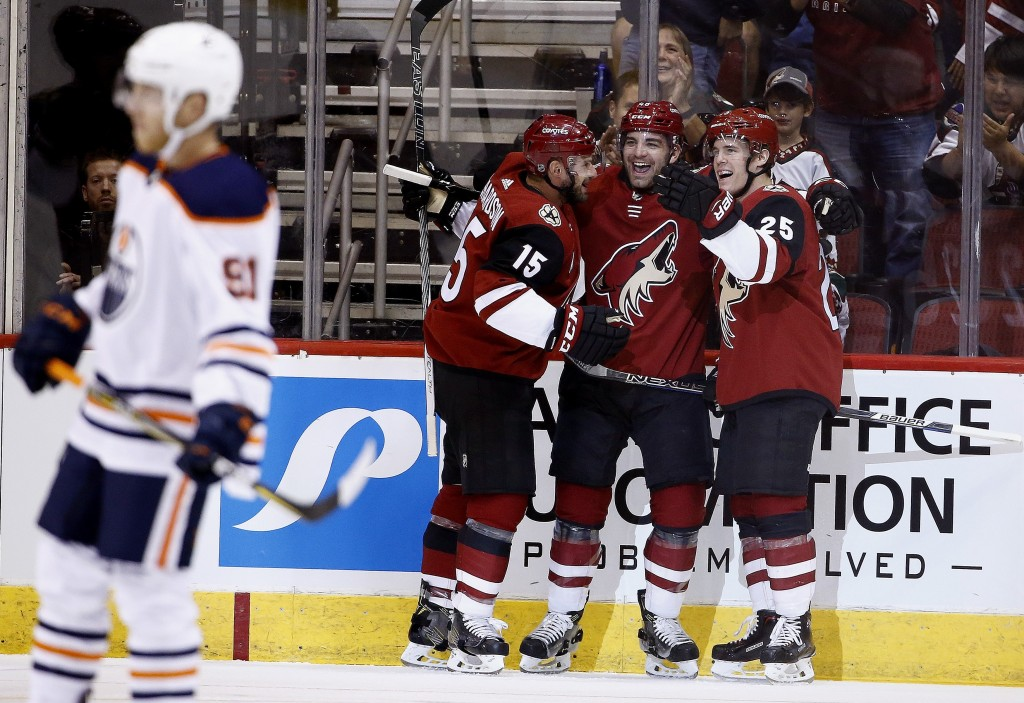 Arizona Coyotes center Brad Richardson (15) celebrates his goal against the Edmonton Oilers with Coyotes left wing Jordan Martinook, second from right