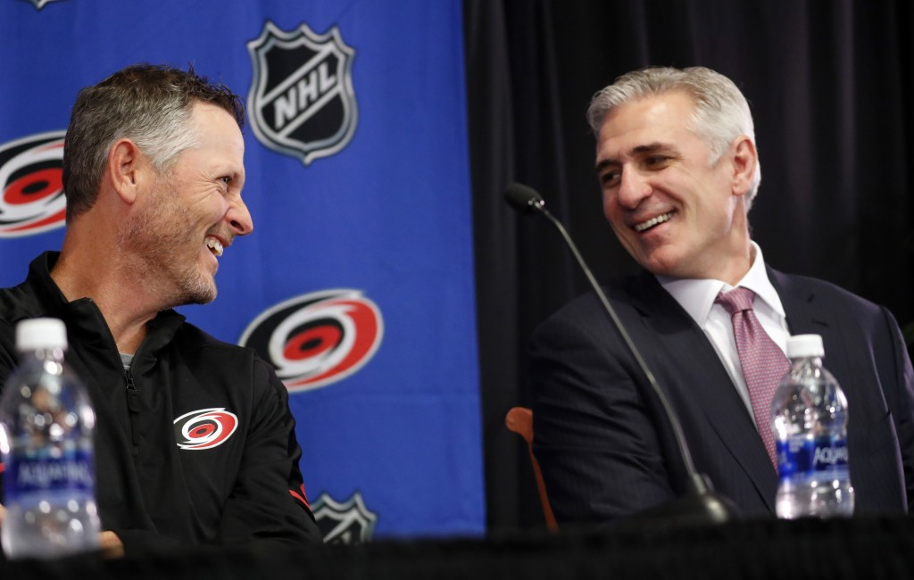 Carolina Hurricanes new NHL hockey team majority owner Thomas Dundon, left, chats with team general manager Ron Francis during an introductory press c