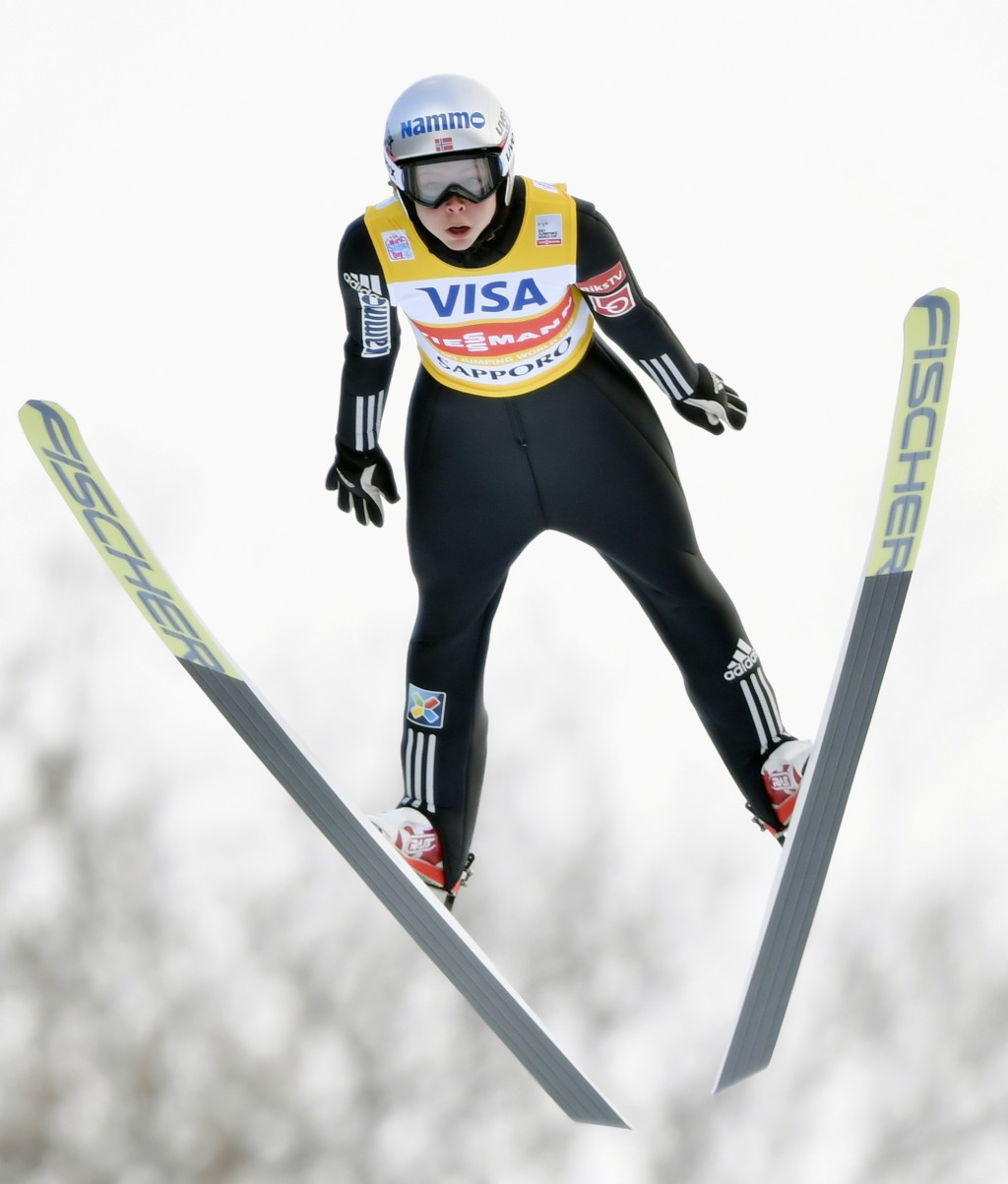 Maren Lundby of Norway soars through the air on her way to her win a World Cup ski jumping event in Sapporo, northern Japan, Saturday, Jan. 13, 2018.