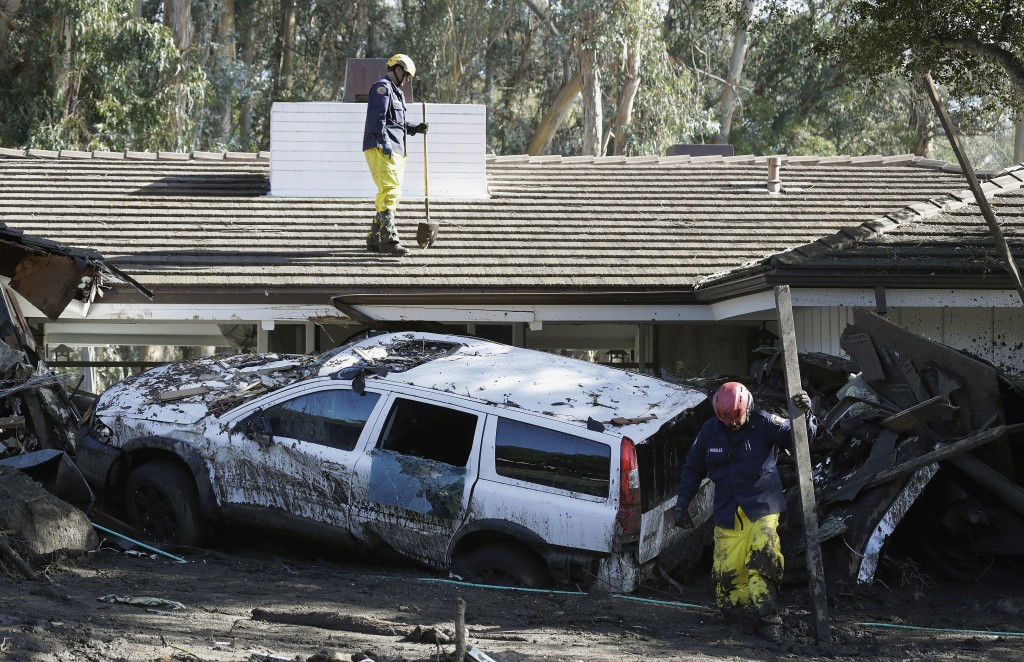 Emergency crew members search an area damaged by storms in Montecito, Calif., Friday, Jan. 12, 2018. The number of missing after a California mudslide