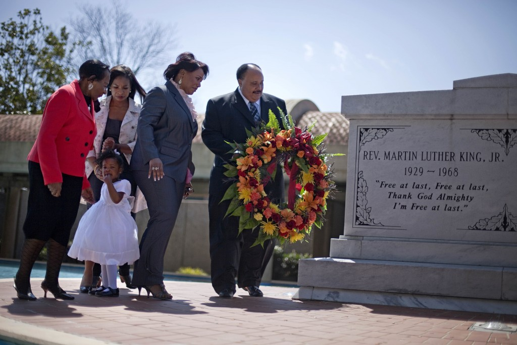 FILE- In this April 4, 2011 file photo, Martin Luther King III, right, the son of Rev. Martin Luther King Jr., lays a wreath at the crypt of his fathe
