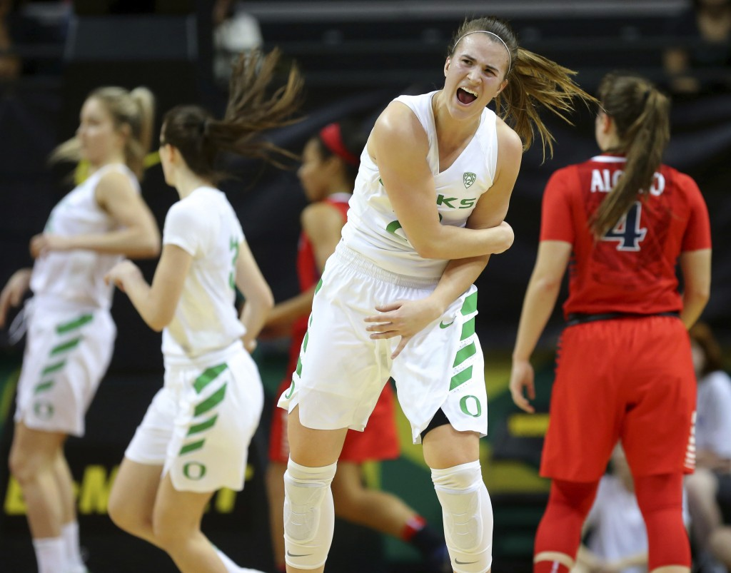 Oregon's Sabrina Ionescu celebrates the first of her four 3-pointers against Arizona during an NCAA college basketball game in Eugene, Ore., Friday, J