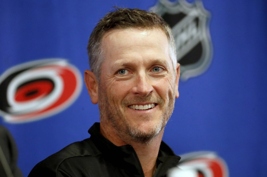 Carolina Hurricanes new NHL hockey team majority owner Thomas Dundon smiles during an introductory press conference at PNC Arena in Raleigh, N.C., Fri