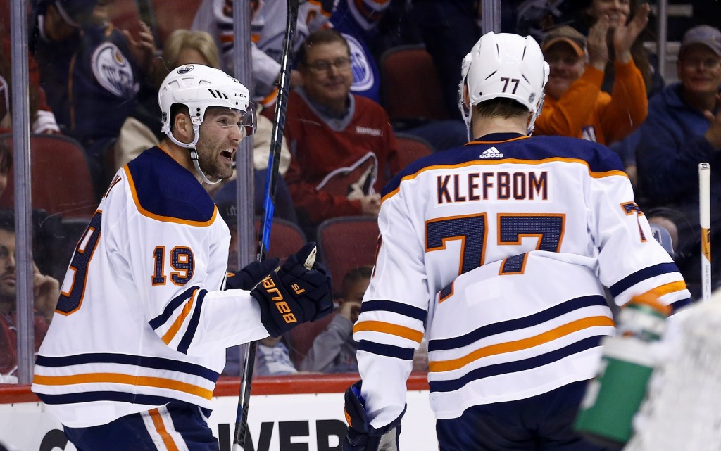 Edmonton Oilers left wing Patrick Maroon (19) celebrates his goal against the Arizona Coyotes with defenseman Oscar Klefbom (77) during the first peri