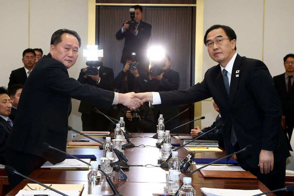 FILE - In this Tuesday, Jan. 9, 2018, file photo, South Korean Unification Minister Cho Myoung-gyon, right, shakes hands with the head of North Korean