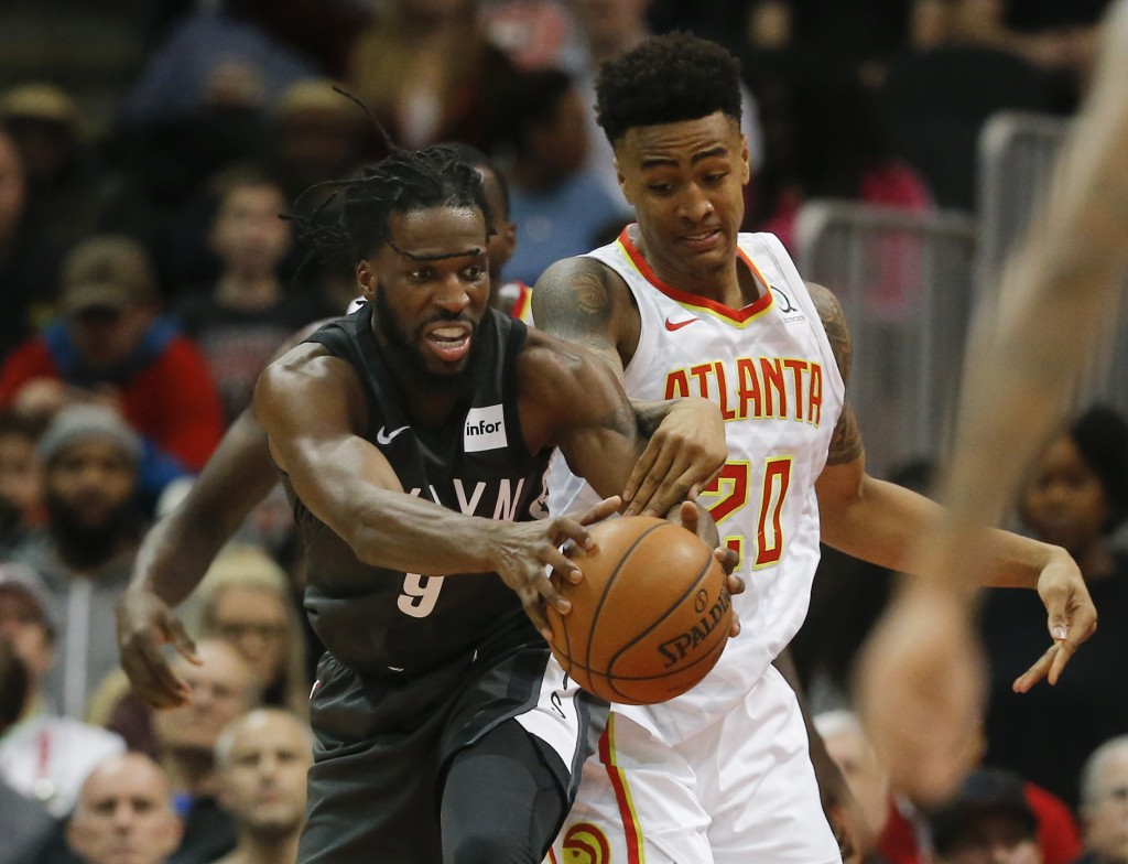 Brooklyn Nets forward DeMarre Carroll (9) and Atlanta Hawks forward John Collins (20) battle for the ball in the first half of an NBA basketball game
