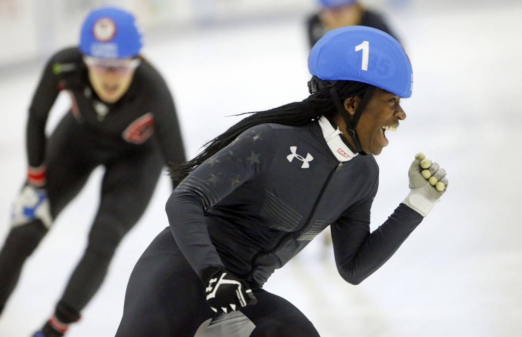 FILE - In this Dec. 16, 2017, file photo, Maame Biney (1) celebrates after winning the women's 500-meter final A during the U.S. Olympic short track s