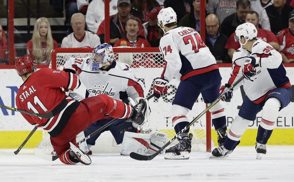 Carolina Hurricanes' Jordan Staal (11) scores against Washington Capitals goalie Philipp Grubauer (31), of Germany, during the first period of an NHL