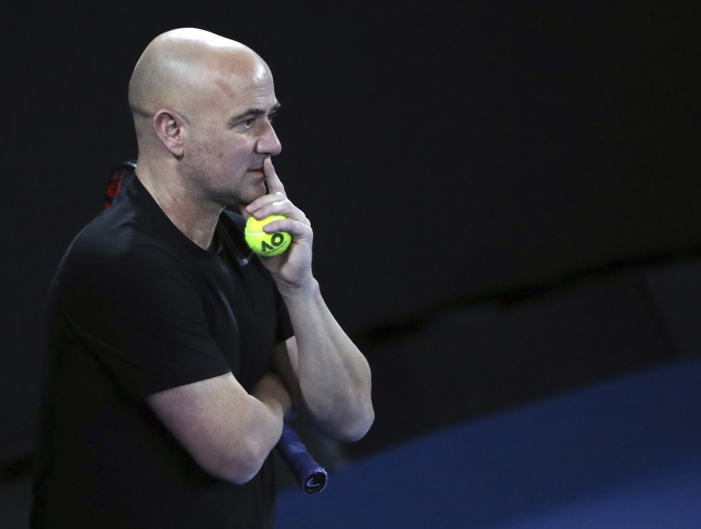 Novak Djokovic's coach Andre Agassi watches him train during a practice session ahead of the Australian Open tennis championships in Melbourne, Austra
