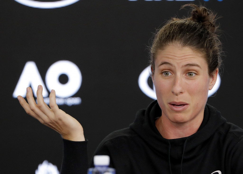Britain's Johanna Konta gestures during a press conference at the Australian Open tennis championships in Melbourne, Australia, Saturday, Jan. 13, 201