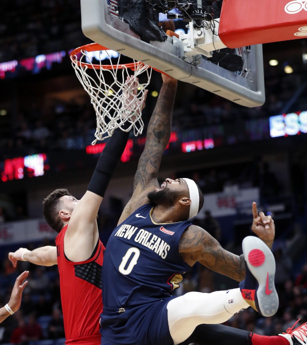 New Orleans Pelicans center DeMarcus Cousins (0) goes to the basket against Portland Trail Blazers center Jusuf Nurkic during the first half of an NBA