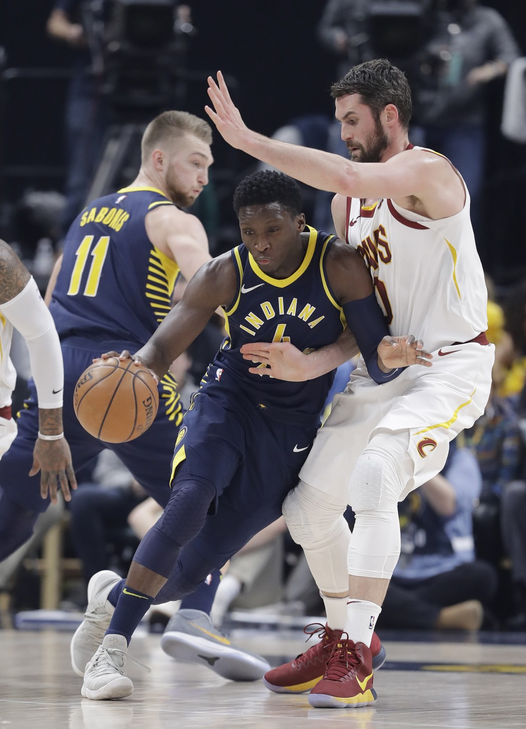 Indiana Pacers' Victor Oladipo (4) is defended by Cleveland Cavaliers' Kevin Love during the first half of an NBA basketball game, Friday, Jan. 12, 20
