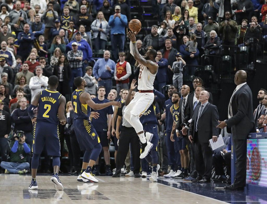 Cleveland Cavaliers' LeBron James misses a basket as time expires in an NBA basketball game against the Indiana Pacers, Friday, Jan. 12, 2018, in Indi