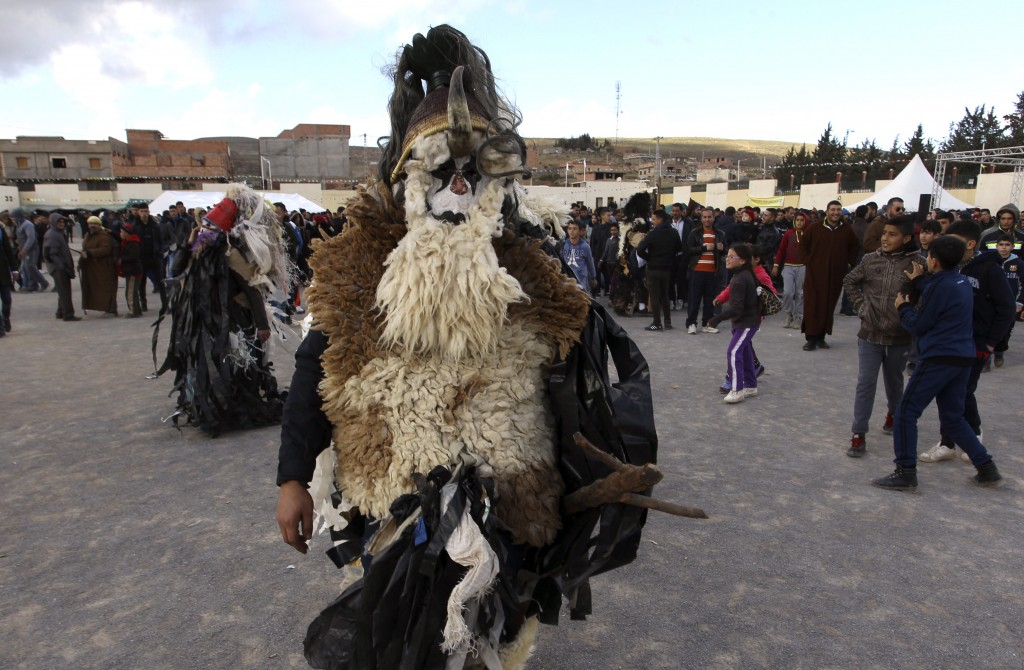 A disguised man parades in the village of Beni Snous, south of Tlemcen, Algeria, Thursday, Dec.11, 2018. Algerians in the Beni Snous region dress in e