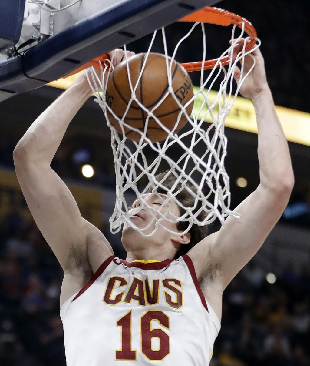 Cleveland Cavaliers' Cedi Osman dunks during the first half of an NBA basketball game against the Indiana Pacers, Friday, Jan. 12, 2018, in Indianapol