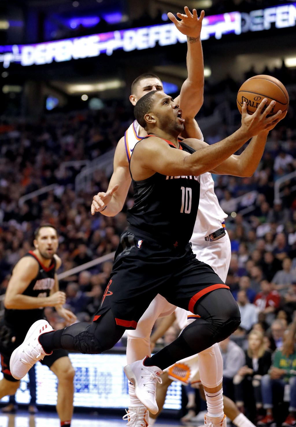 f3bca026263f Houston Rockets guard Eric Gordon (10) slips past Phoenix Suns center Alex  Len during