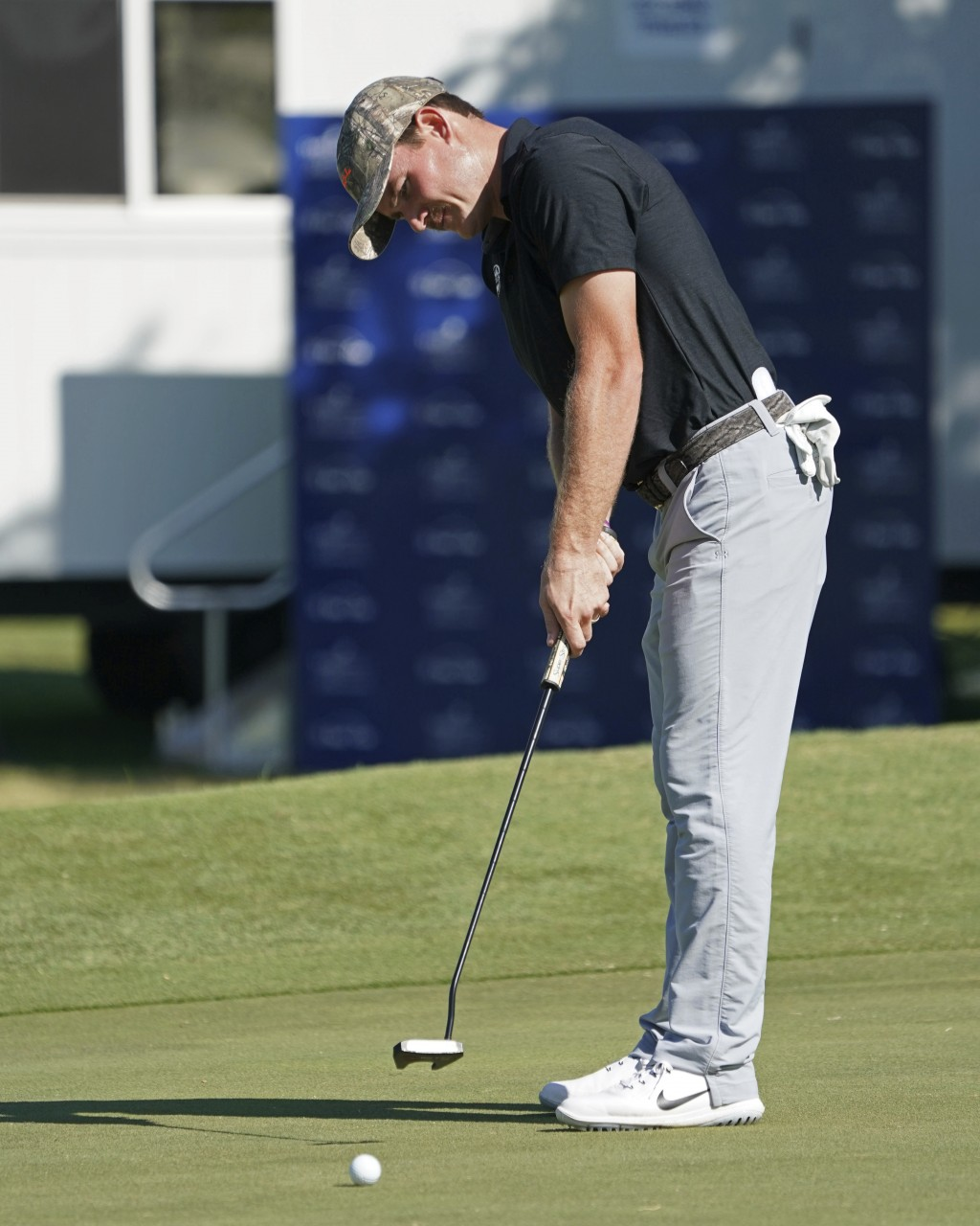 John Peterson putts on the ninth green during the second round of the Sony Open golf tournament, Friday, Jan. 12, 2018, in Honolulu. (AP Photo/Marco G