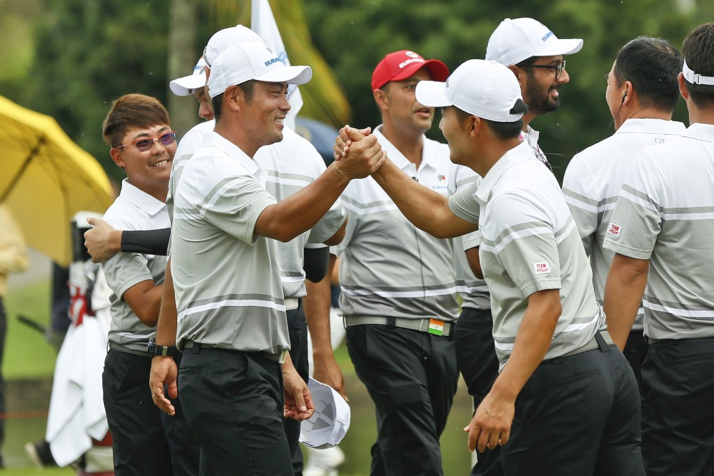Hideto Tanihara of Japan, left, and Kang Sung-hoon of South Korea, right, celebrate winning the foursome matches during the 2018 EurAsia Cup golf tour