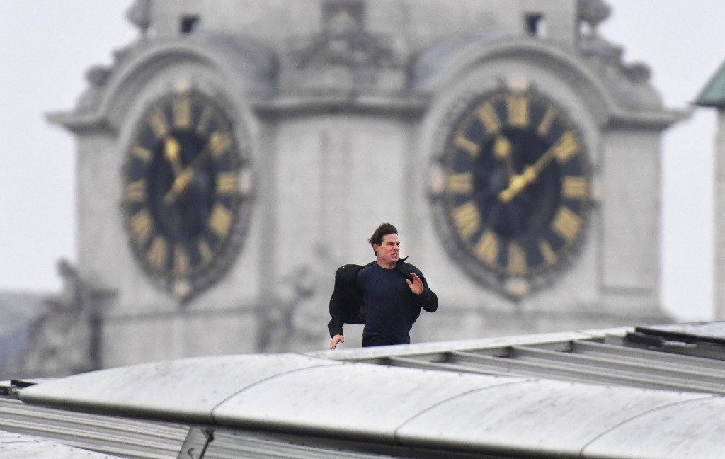 Actor Tom Cruise runs along the rooftop of Blackfriars station, during filming for the new Mission Impossible 6 film, in London, Saturday Jan. 13, 201