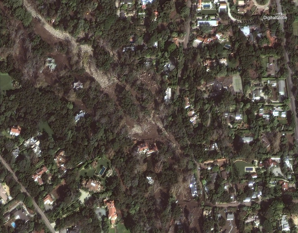 This Jan. 11, 2018 satellite image released by DigitalGlobe News Bureau shows an area of homes after storms caused mudslides and flooding in Montecito