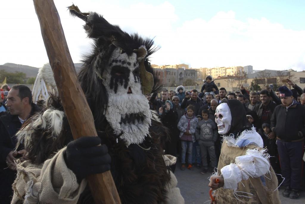 Disguised men perform in the village of Beni Snous, south of Tlemcen, Algeria, Thursday, Dec.11, 2018. Algerians in the Beni Snous region dress in ela