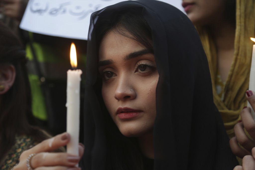A Pakistani girl joins others during a memorial for Zainab Ansari, an 8-year-old girl who was kidnapped, raped and killed last week, in Lahore, Pakist