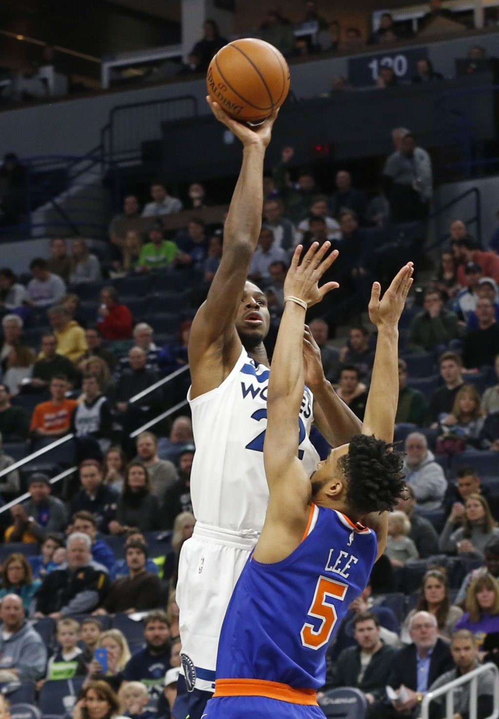 Minnesota Timberwolves' Andrew Wiggins, top, shoots over New York Knicks' Courtney Lee in the first half of an NBA basketball game Friday, Jan. 12, 20