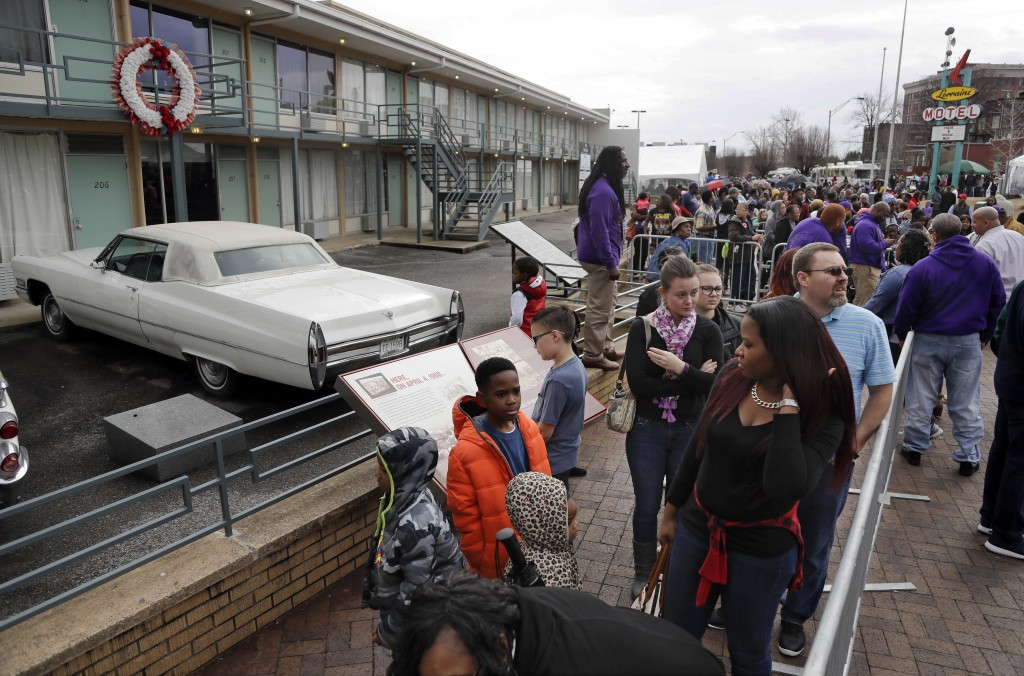 FILE - In this Monday, Jan. 16, 2017, file photo, people wait in line to enter the National Civil Rights Museum on Martin Luther King Jr. Day in Memph