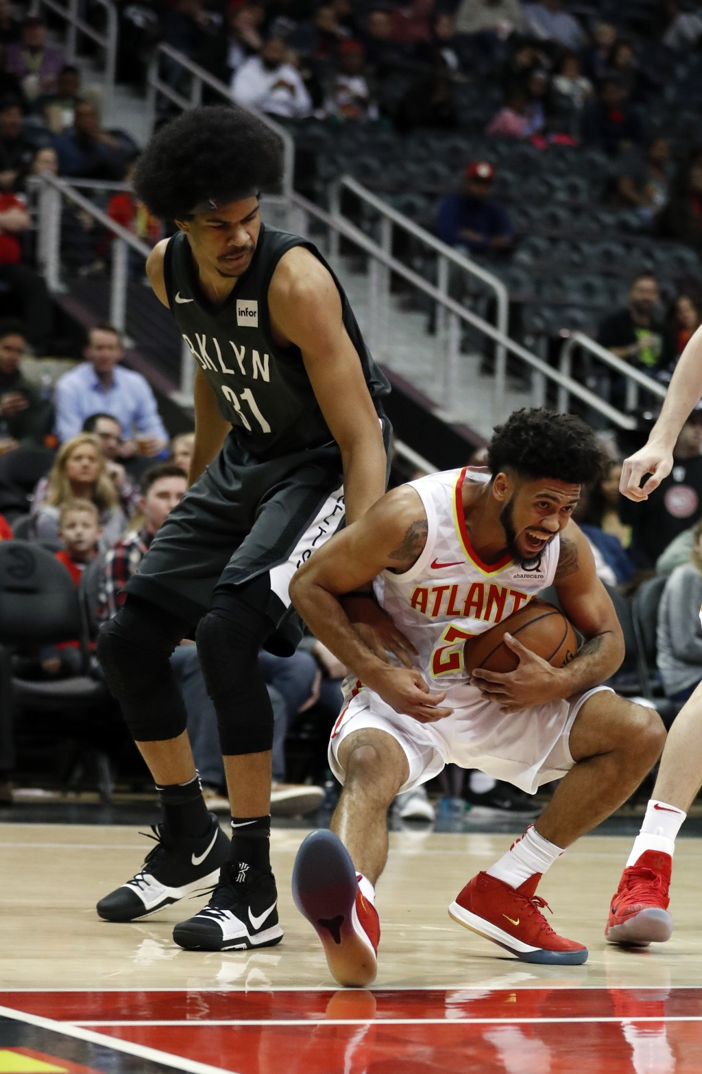 Atlanta Hawks guard Tyler Dorsey (2) comes down with a rebound against Brooklyn Nets center Jarrett Allen (31) in the first half of an NBA basketball