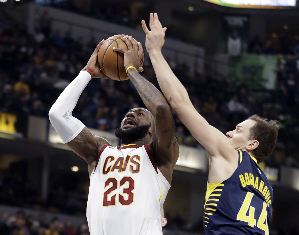 Cleveland Cavaliers' LeBron James (23) shoots against Indiana Pacers' Bojan Bogdanovic during the first half of an NBA basketball game, Friday, Jan. 1