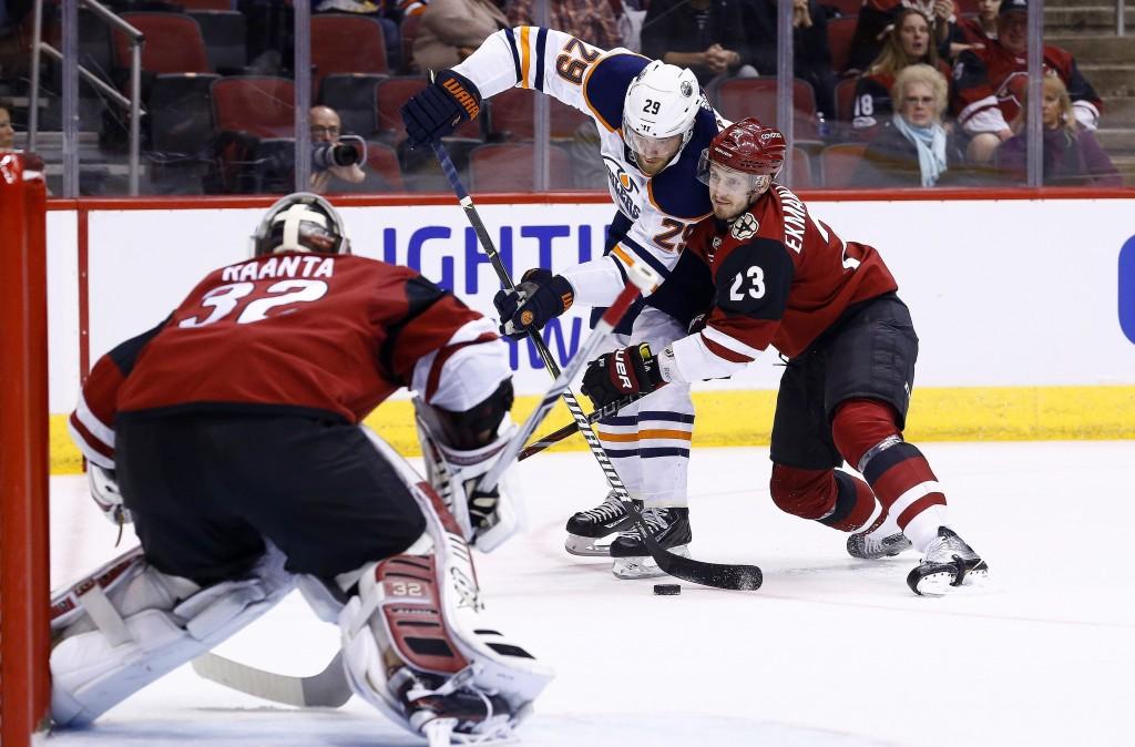 Arizona Coyotes defenseman Oliver Ekman-Larsson (23) shoves Edmonton Oilers center Leon Draisaitl (29) off his shot as Coyotes goaltender Antti Raanta
