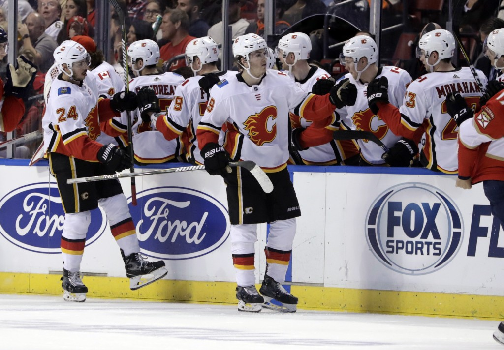 Calgary Flames' Matthew Tkachuk (19) is congratulated after scoring a goal during the second period of the team's NHL hockey game against the Florida