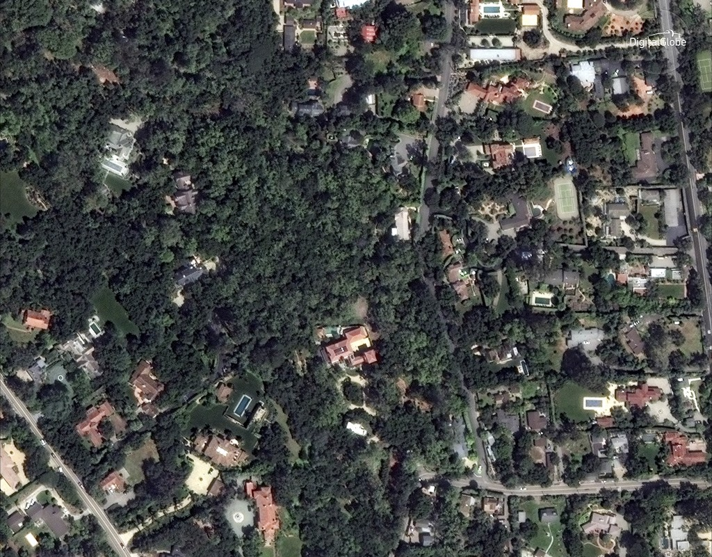 This April 8, 2017 satellite image released by DigitalGlobe News Bureau shows an area of homes in Montecito, Calif. The number of missing after a Cali