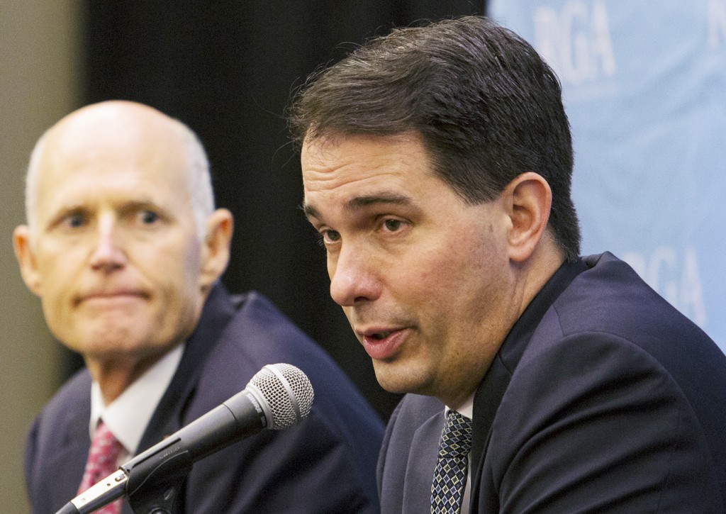FILE - In this Nov. 15, 2017, file photo, Wisconsin Gov. Scott Walker answers questions during the Republican Governors Association's Annual Conferenc