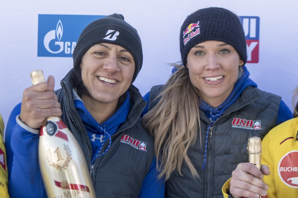 Elena Meyers Taylor, left,  and Lolo Jones, from USA  celebrate their victory after the Women's  Bob Sledge World Cup in St. Moritz, Switzerland, on S