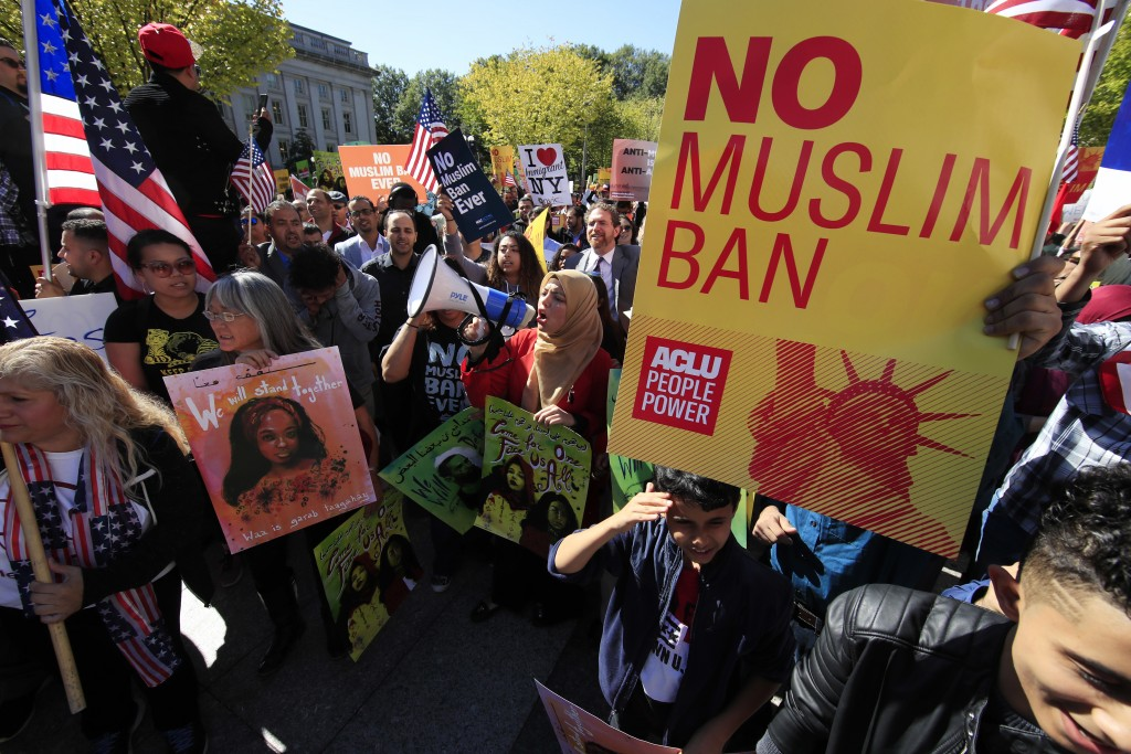 FILE - In this Oct. 18, 2017, file photo, protesters gather at a rally in Washington. President Donald Trump often brags that he's done more in his fi